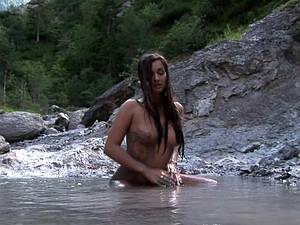 Sexy Ennie taking a mudbath