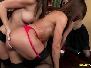 Two horny schoolgirls in skirts seduces their friend during a lesson