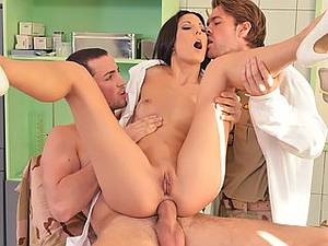 Double penetration in the hospital. Lustful nurse takes two dicks