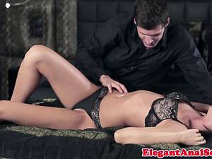 Woman in lingerie gets her rear penetrated by hard cock